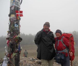 John and Ali at the Cruz de Ferro which occupies the highest point of the entire Camino Frances. The site consists of a tall wooden pole topped with a iron cross. This is said to be an ancient monument, first erected by the ancient Celts, then dedicated by the Romans to their god Mercury (protector of travellers) and later crowned by the cross and renamed as a Christian site by the 9th century hermit Guacelmo. For centuries, pilgrims have brought a stone to this place from home to lay down their burden, leaving them lighter (literally and figuratively) for the journey ahead.