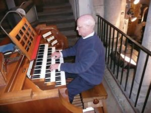 John playing the organ