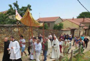 The monks lead the villagers in the Corpus Christi procession