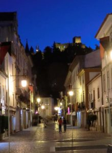 Tomar by night and The Templar Castle on the hill