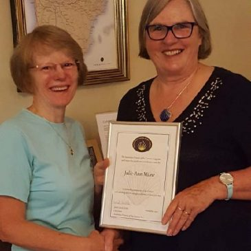 Janet presenting Julie-Ann Milne with a certificate of recognition for her hospitalero training work